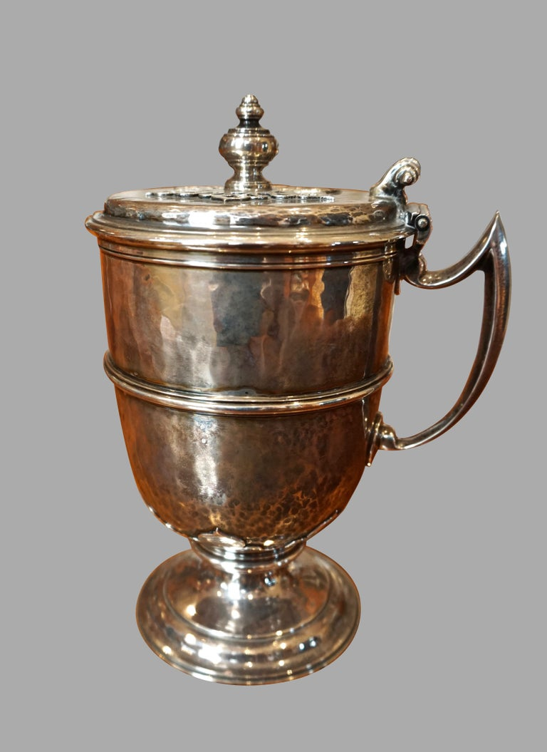 An English sterling silver covered handled cup hallmarked for London 1911, made and stamped by Johnson Walker & Tolhurst. A copy of the Maundy ewer.
