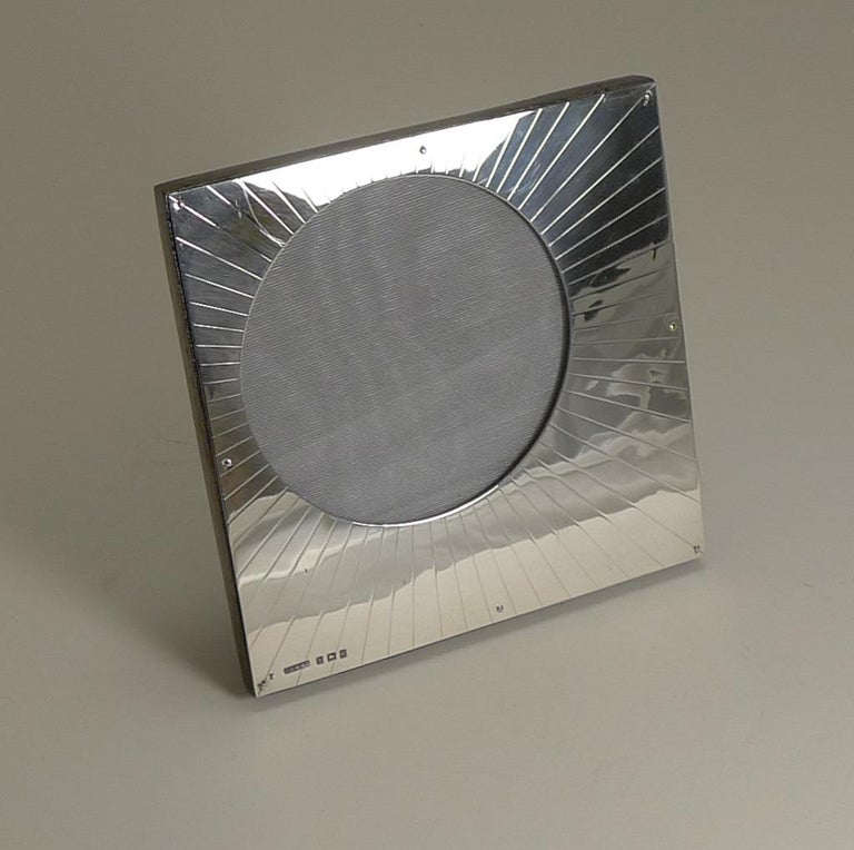 This fabulous looking photograph frame with it's off-centre circular aperture and it's engraved