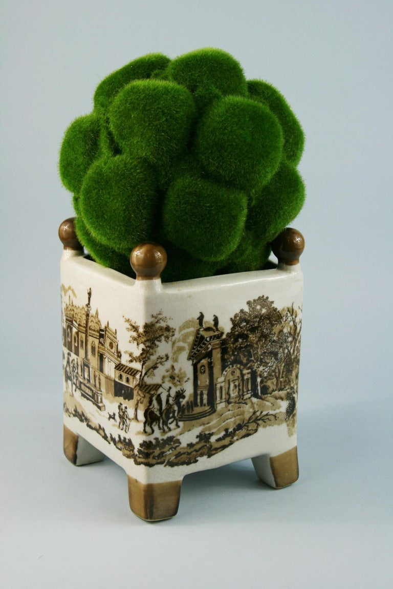 3-496 English stoneware vase with different county scenes on each size with faux topiary. Can be use as a planter Planter size: 8 x 8 x 9