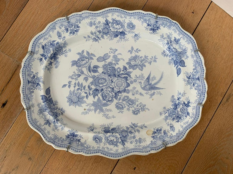 Late 19th-early 20th century English blue and white transferware porcelain oval charger in Asiatic Pheasants pattern.