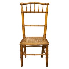 English Turn of the Century 1900s Bamboo Slipper Chair with Cane Seat