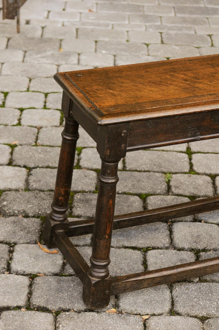English Turn of the Century Oak Bench with Turned Base and Side Stretcher, 1900s 4