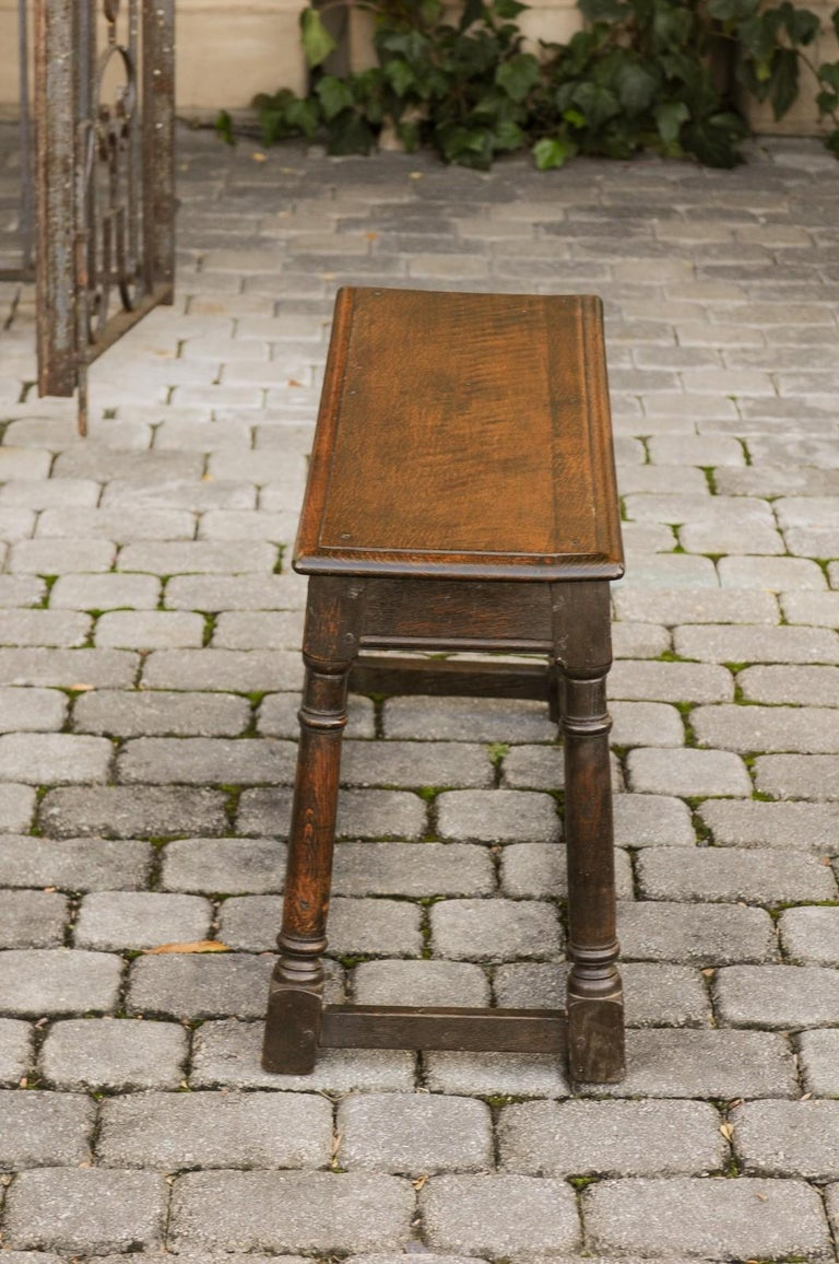 English Turn of the Century Oak Bench with Turned Base and Side Stretcher, 1900s 7