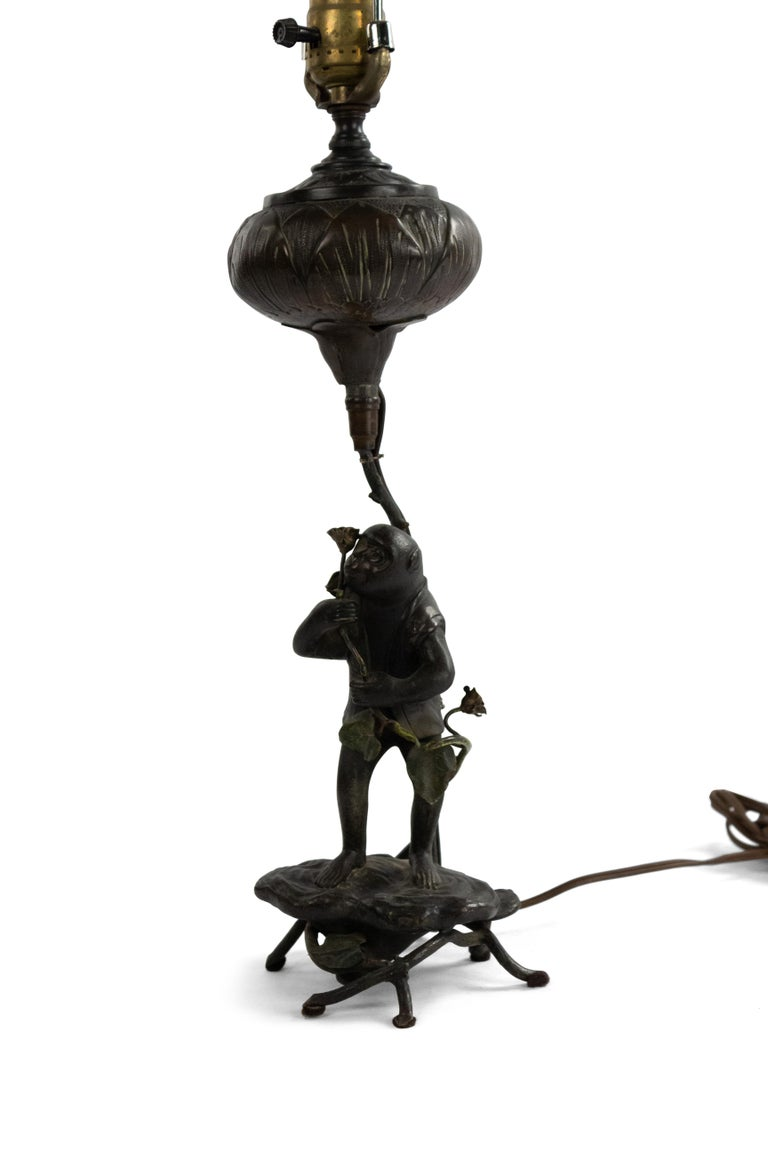 English Victorian bronze fantasy table lamp of monkey holding flower.