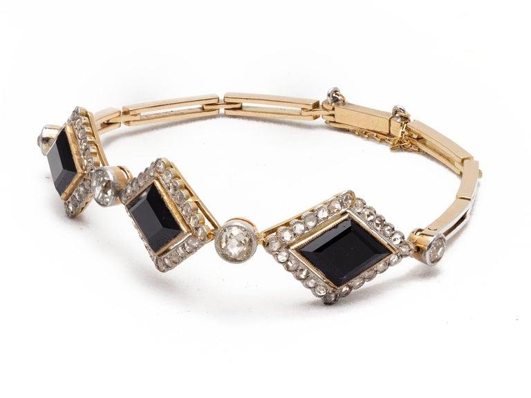 Old Mine Cut English Victorian Era Lozenge Onyx and Diamond Bracelet in 18k Gold, circa 1880 For Sale