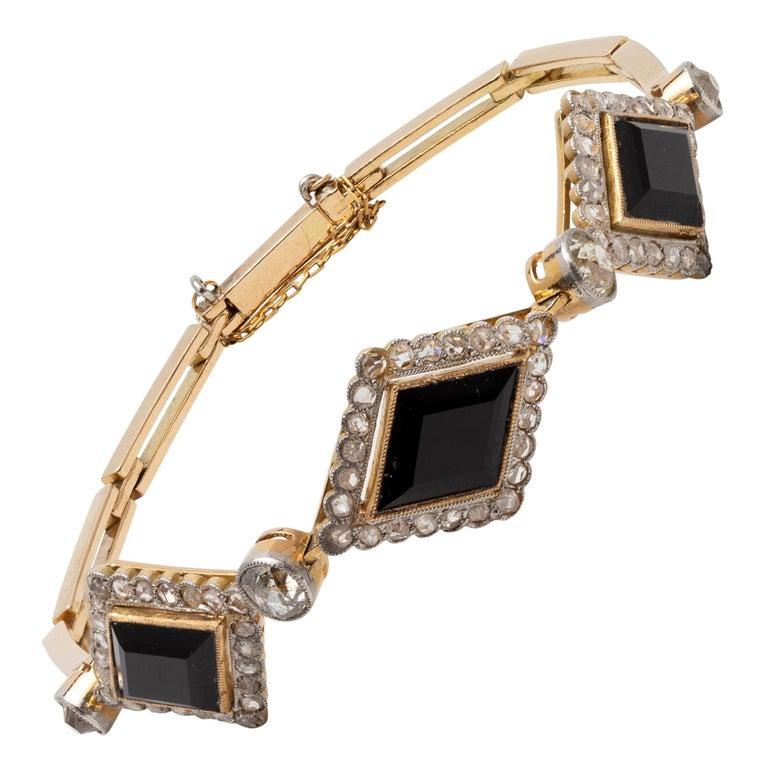 English Victorian Era Lozenge Onyx and Diamond Bracelet in 18k Gold, circa 1880 For Sale