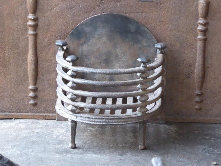 English Victorian fireplace grate made of cast iron and wrought iron.