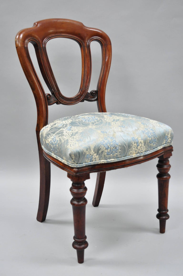 Set of four antique 19th century English Victorian solid mahogany chairs. Item features authentic warm patina, turn carved legs, heavy solid wood construction, beautiful wood grain, upholstered seats, nicely carved details, circa 19th century.