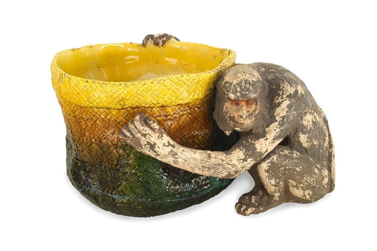 English Victorian (Majolica) porcelain green and yellow basket form jardinière being held by a seated monkey figure (AS IS-repair to bottom) (stamps: BRETBY ENGLAND).