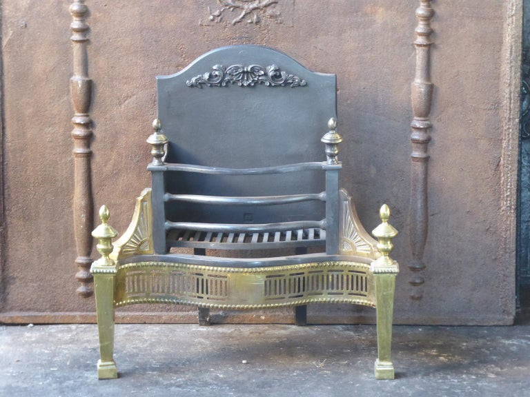 English Victorian style fireplace basket or fire basket. The fireplace grate is made of wrought iron and brass.