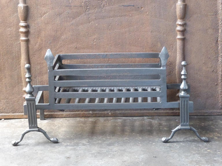 English Victorian style fireplace basket or fire basket. The fireplace grate is made of wrought iron and brass. The total width of the front of the grate is 35 inch (89 cm).