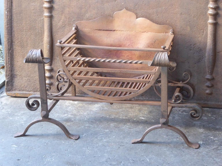 English Victorian style fireplace basket or fire basket. The fireplace grate is made of wrought iron. The grate has a natural brown patina. Upon request it can be made black. The total width of the front of the grate is 29 inch (74