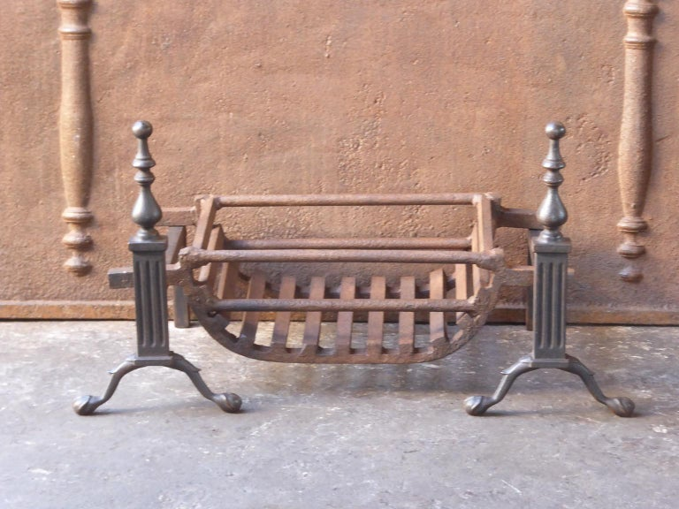 English Victorian style fireplace basket or fire basket. The fireplace grate is made of wrought iron and cast iron. The grate has a natural brown patina. Upon request it can be made black. The total width of the front of the grate is 27 inch (68