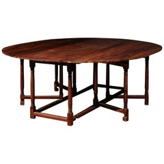 English Walnut Oval Top Drop-Leaf Gateleg Table with Turned Legs and Stretchers