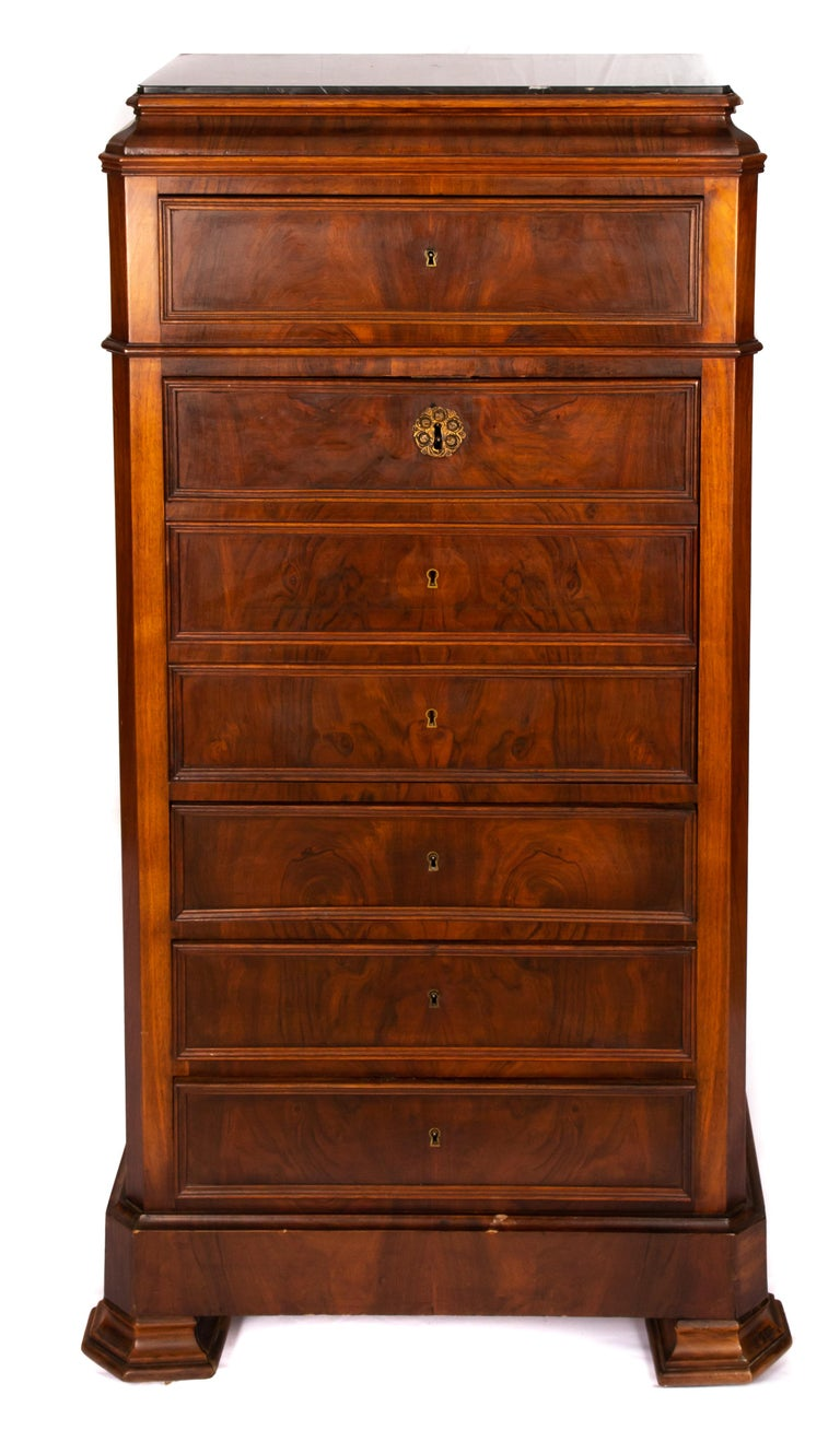 Offering this stunning English walnut burled wood secretary. Starting on the bottom with a slightly raised foot. There are 3 drawers on the bottom. Above that there is a drop door that opens to 2 drawers over one longer one. At the top is a single