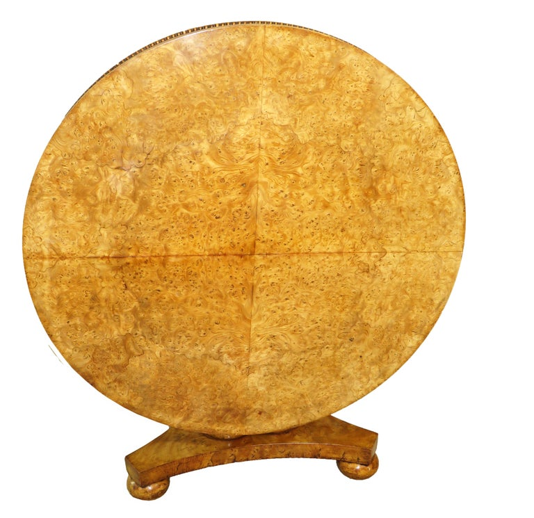 A very fine quality william iv period english Burr elm centre table having superbly figured Quarter veneered circular tilting top raised on Unusual turned cluster column central support With triform base and elegant turned bun feet  (This