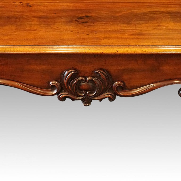 William IV mahogany library table This William IV mahogany library table was made circa 1830. The library table stands on faceted and carved end supports that stand on well carved paw feet. It is fitted a central drawer with a shaped
