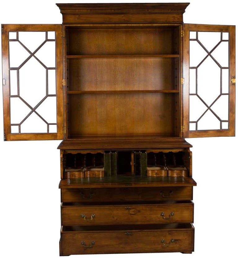 This yew secretary bookcase, also known as a bureau desk, is handmade in England as a Georgian period reproduction. Every aspect of this English-made secretary desk, from the techniques used to the materials themselves, is of the absolute highest