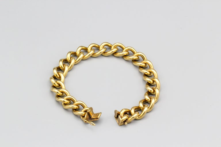 Interesting 18k gold link bracelet, of English origin circa 1960s.  It weighs a hefty 73.7 grams and measures over 7.5 inches long.  Hallmarks: maker's marks, 18ct