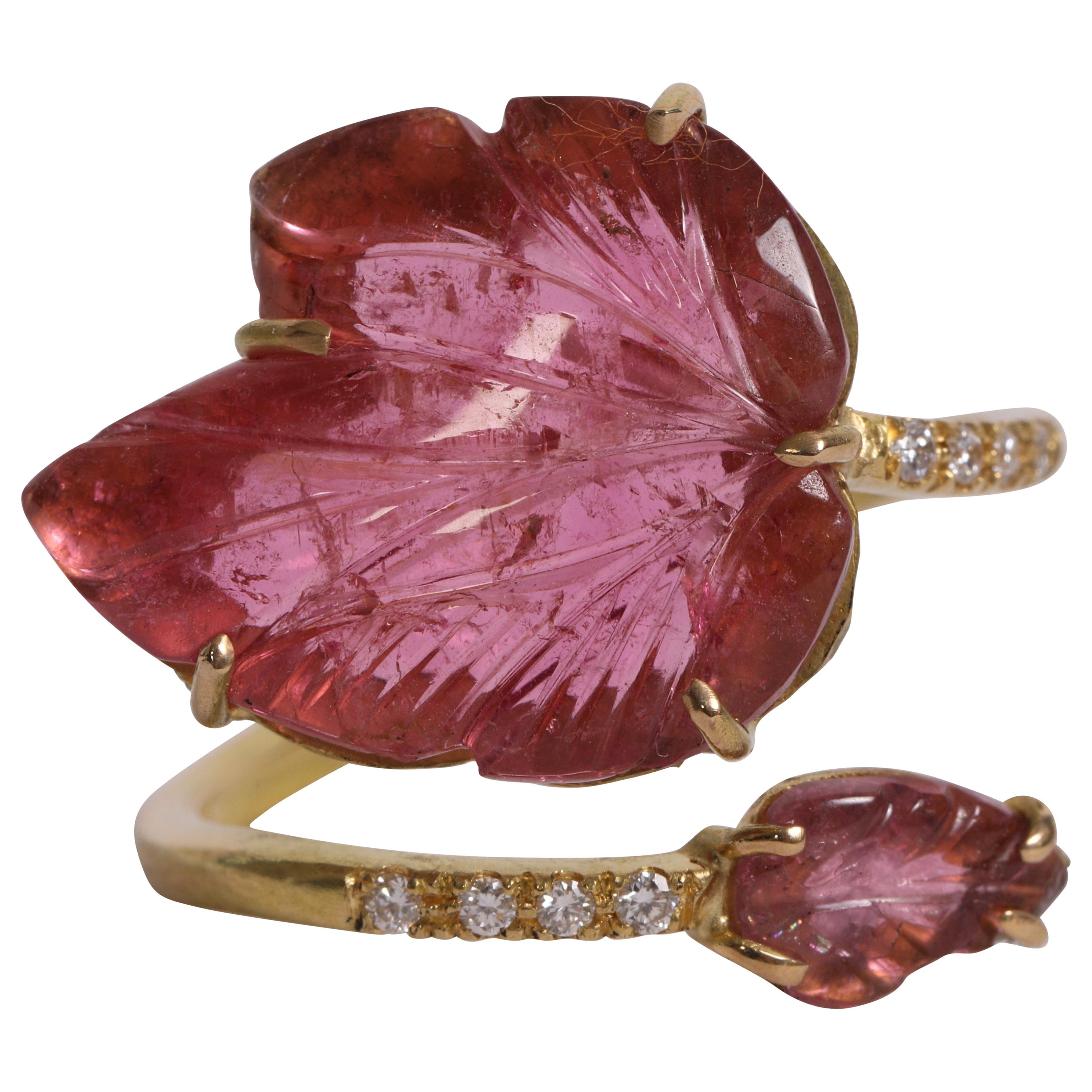 18K Yellow Gold Ring Set With Two Engraved Pink Tourmalines and Diamonds.