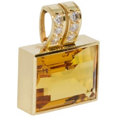 Enhancer, 18 Karat Gold with Large Faceted Citrine in Emerald Cut and Diamonds