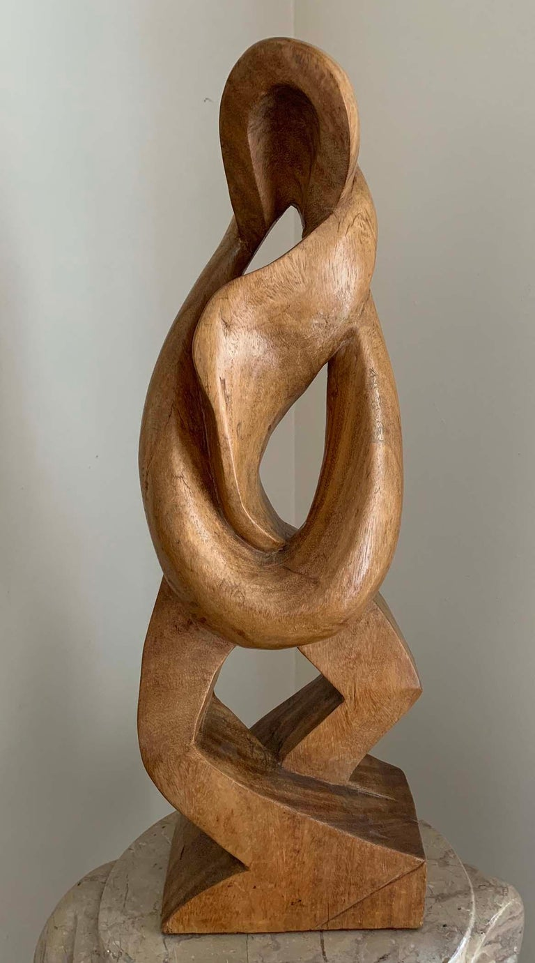 """ENID BELL  """"BASKETBALLERS""""  WOOD, STAMPED BY ESTATE  AMERICAN, C.1940S  25 INCHES  Enid Bell 1904-1994  (Enid Diack (Palanchian) Bell)  Enid Bell was born in London on December 5, 1904. She worked as a sculptor, author, illustrator and professor,"""