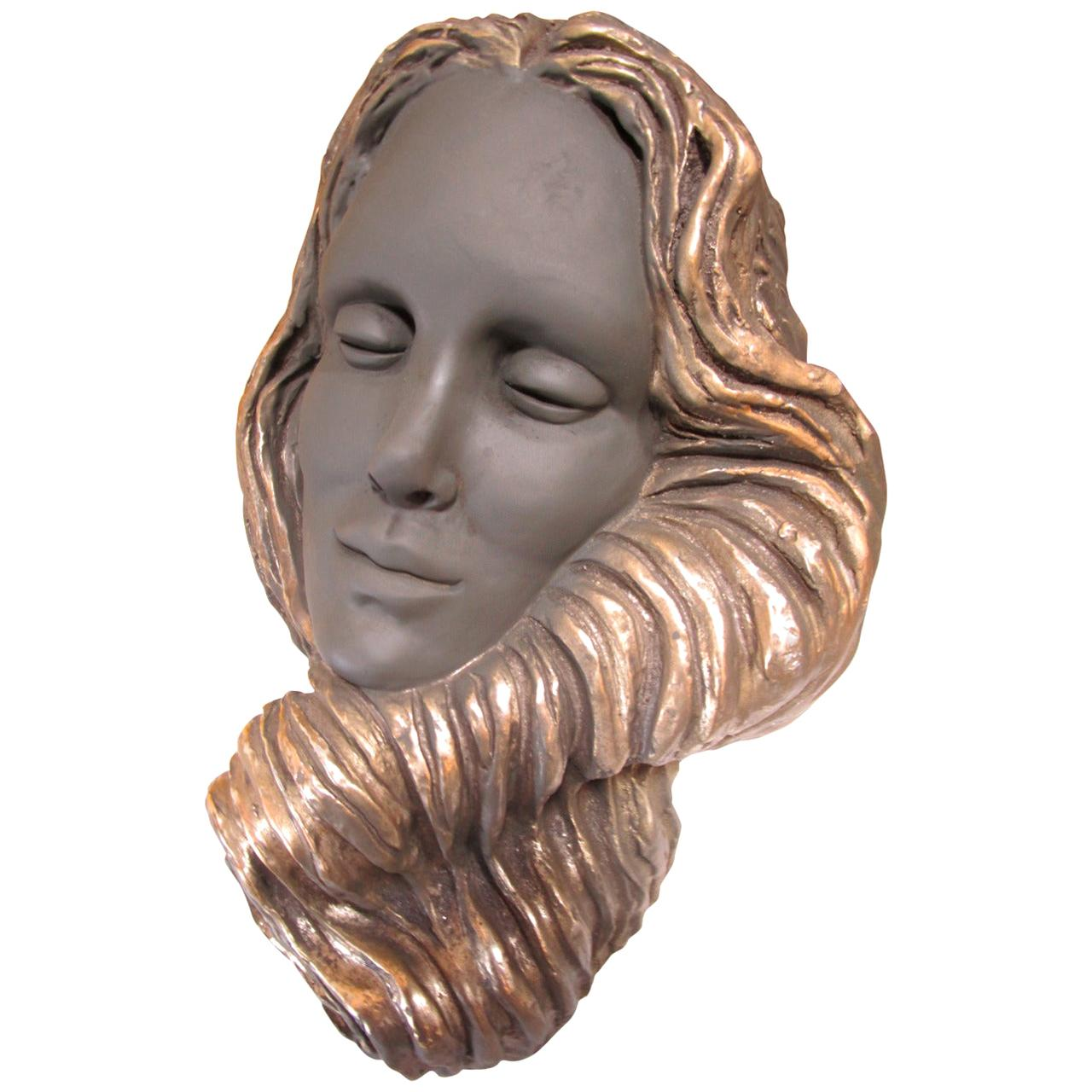 Enigmatic Sculpture of a Mermaid Face
