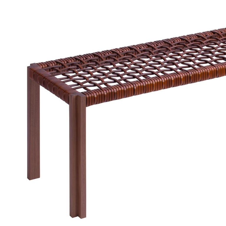 Bench enlaced leather with structure in solid walnut and seat made with enlaced genuine brown leather. Also available in solid walnut in wenge stained with enlaced genuine black leather.