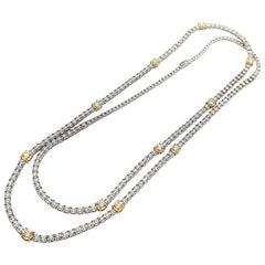 Enlarging Effect Diamond Long Necklace in 18 Karat White and Yellow Gold