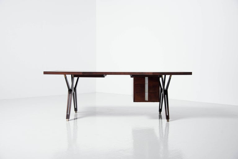 Very nice and large sized rosewood writing desk designed by Ennio Fazioli and was designed after the Terni series which was designed by Ico Parisi and manufactured by MIM Roma, Italy 1958. This desk has a rosewood top and mahogany legs, the top has