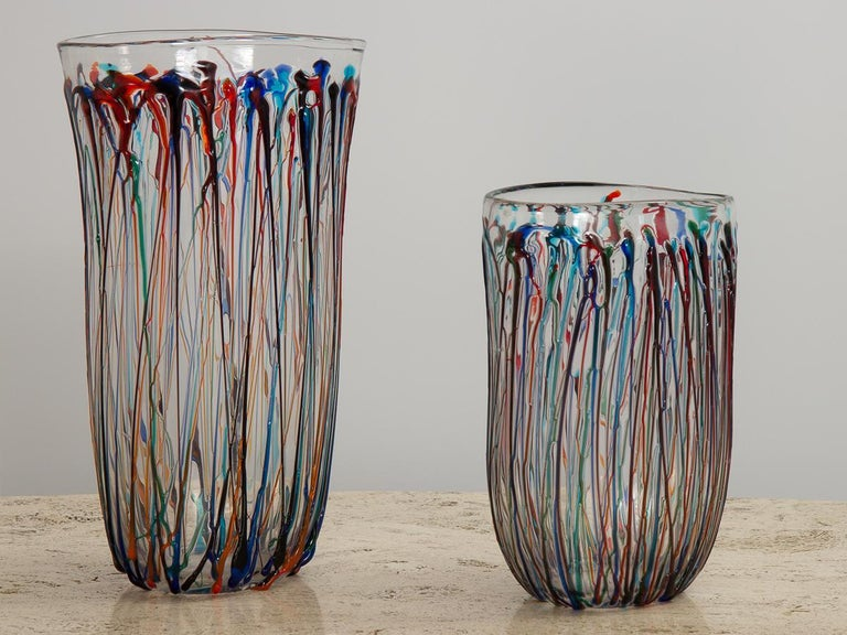 Pair of striking Murano art glass vases, crafted by modern Italian glassmaker Enrico Cammozzo. Oval vases are freely hand blown into an elongated, organic shape, with an abstract applied glass decoration to the exterior. Colorful ribbons of molten