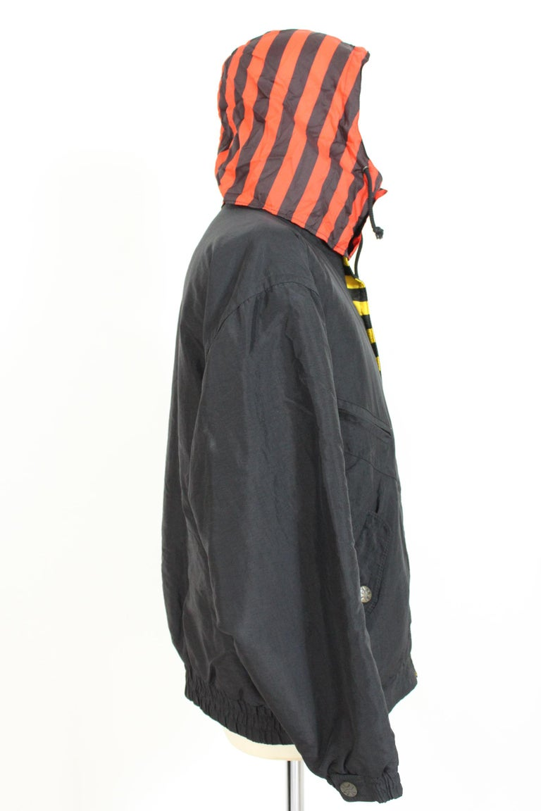 Enrico Coveri vintage 80s jacket. Sport down jacket wide model type bomber, color black and red. Zip and clip button closure, pockets on the sides and chest. Detachable hood. Made in Italy. Excellent vintage conditions.   Size: 46 It 36 Us 36
