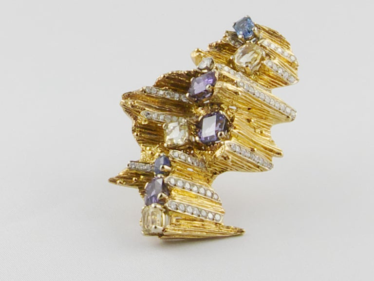A rare, exceptionally crafted Yellow Gold, Diamond and Natural Sapphires 1960s brooch by Enrico Serafini, Firenze In this sensational Italian brooch the finely textured 18 karat Yellow Gold creates an abstract free-form and visual drama for a bold
