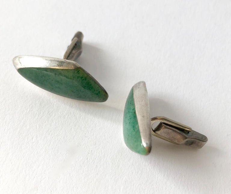 Sterling silver with chrysoprase or agate triangular stones created by Enrique Ledesma of Taxco, Mexico.  Cufflinks measure 1/2