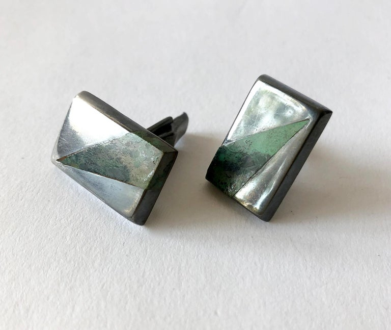 Mexican jade with variegated stone set in darkened sterling silver cufflinks by Enrique Ledesma of Taxco, Mexico.  Cufflinks measure 5/8