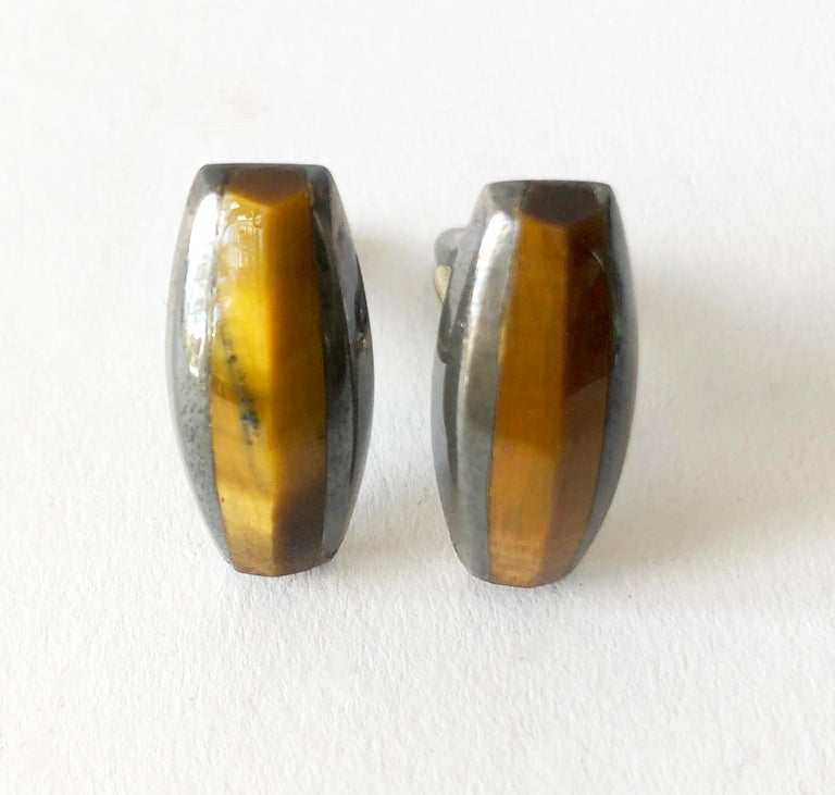 Darkened sterling silver and tiger's eye modernist cufflinks created by Enrique Ledesma of Taxco, Mexico. Cufflinks measure 1