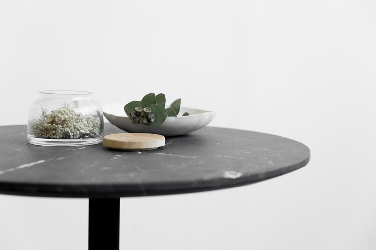 Side table in black Monterrey marble on laser cutting metal structure and electrostatic painting.