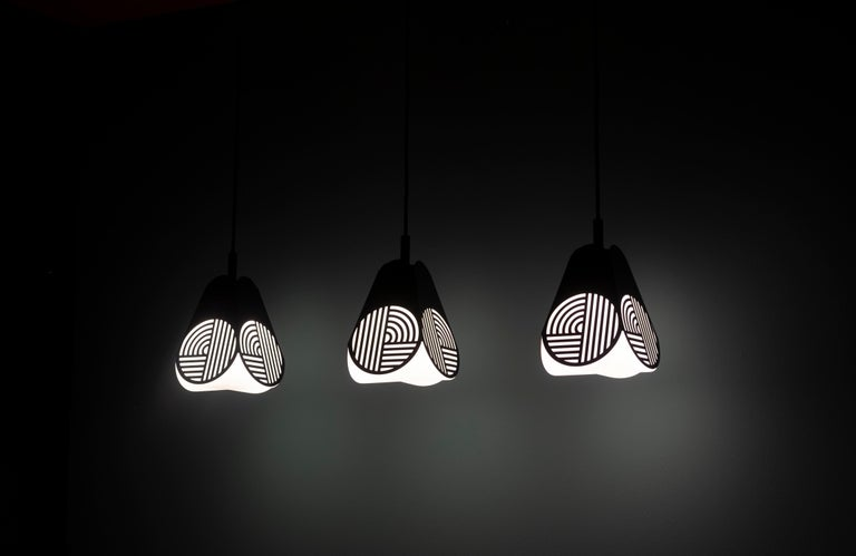 Ensemble of Notic pendant lamps by Bower Studio Dimensions: 18 x 15.5 cm (Ø) (cord length: 300 cm)  Notic is an homage to classical architectural elements. The graphical metal shade embraces the complex geometry of the glass and spreads the