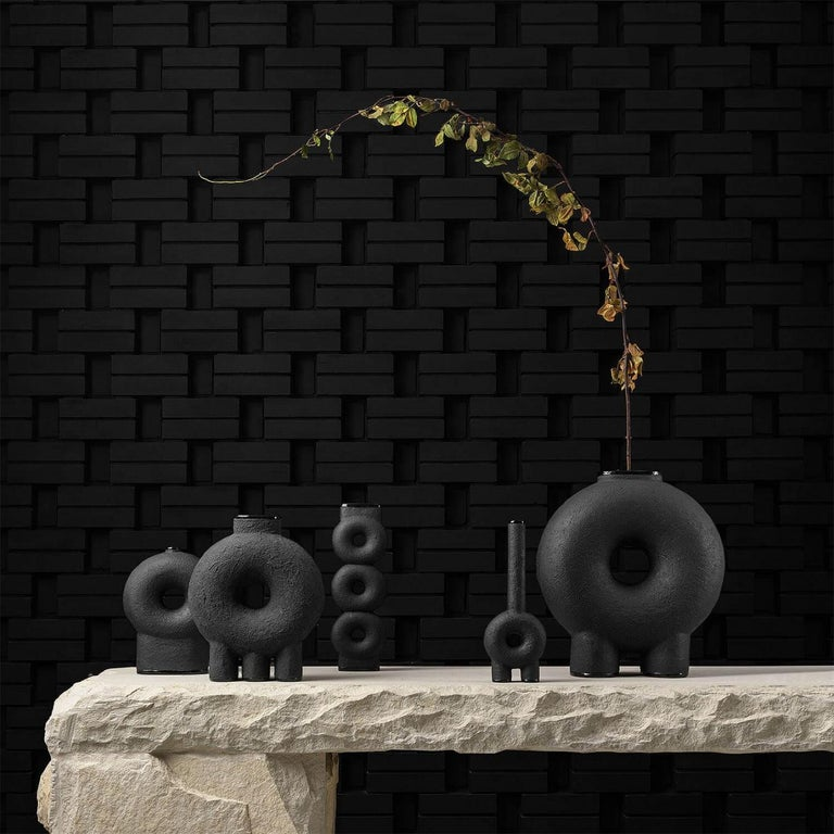 Ensemble of sculpted ceramic vases by Victoria Yakusha Design: Victoriya Yakusha Material: clay / ceramics  The set of vases consists of 5 items:  1. Vase on three legs height 500 x width 200 x length 430 mm. 2. Vase on two legs height 390 x