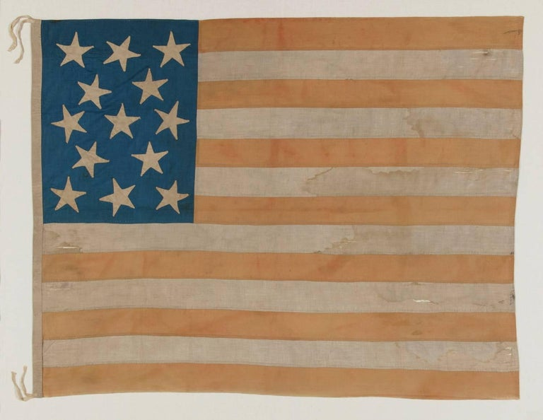 Entirely hand-sewn American National Flag with 13 stars on a tall and narrow canton; a homemade example with interesting presentation, made sometime between the tail end of the civil war and the 1876 centennial:  Despite the fact that America