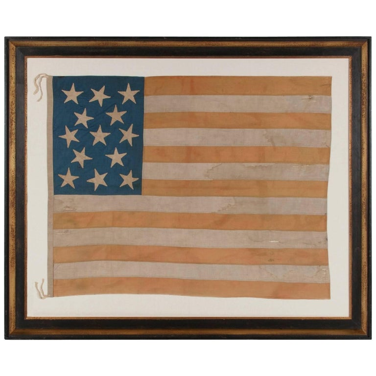 Hand-sewn American flag with 13 stars on a tall canton, 1864–76