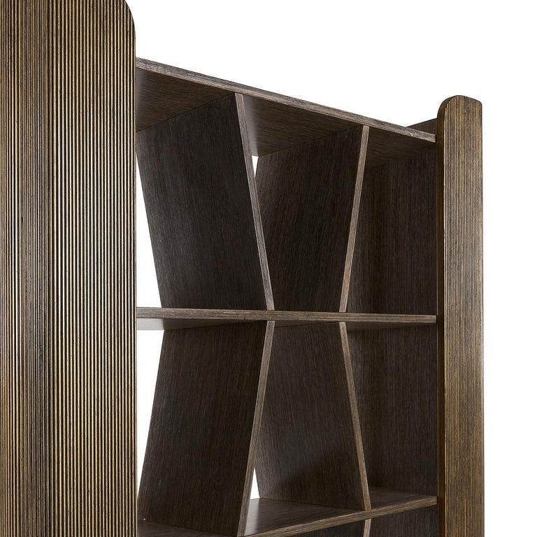 Bold and sophisticated this bookcase will be a striking addition to a contemporary home. Either against a wall, or used as superb room divider, this piece of functional decor will make a statement, thanks to its noble materials, unique designer, and