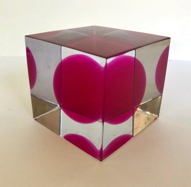 Lucite cube with internal red sphere.