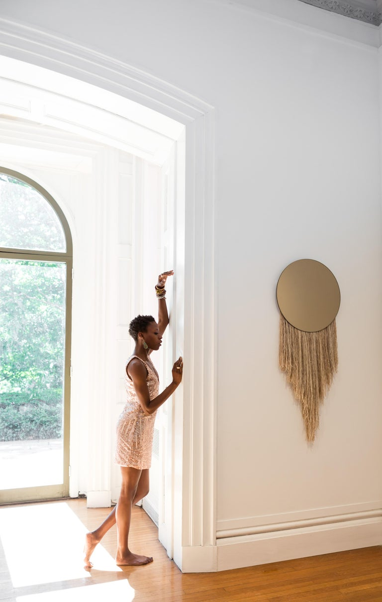 Named after the ancient Greek goddess of Dawn, the Eos mirror explores the relationship between the functional and nonfunctional elements of objects, including the utility of a mirror with the warmth and joie de vivre of fiber.  Customization in