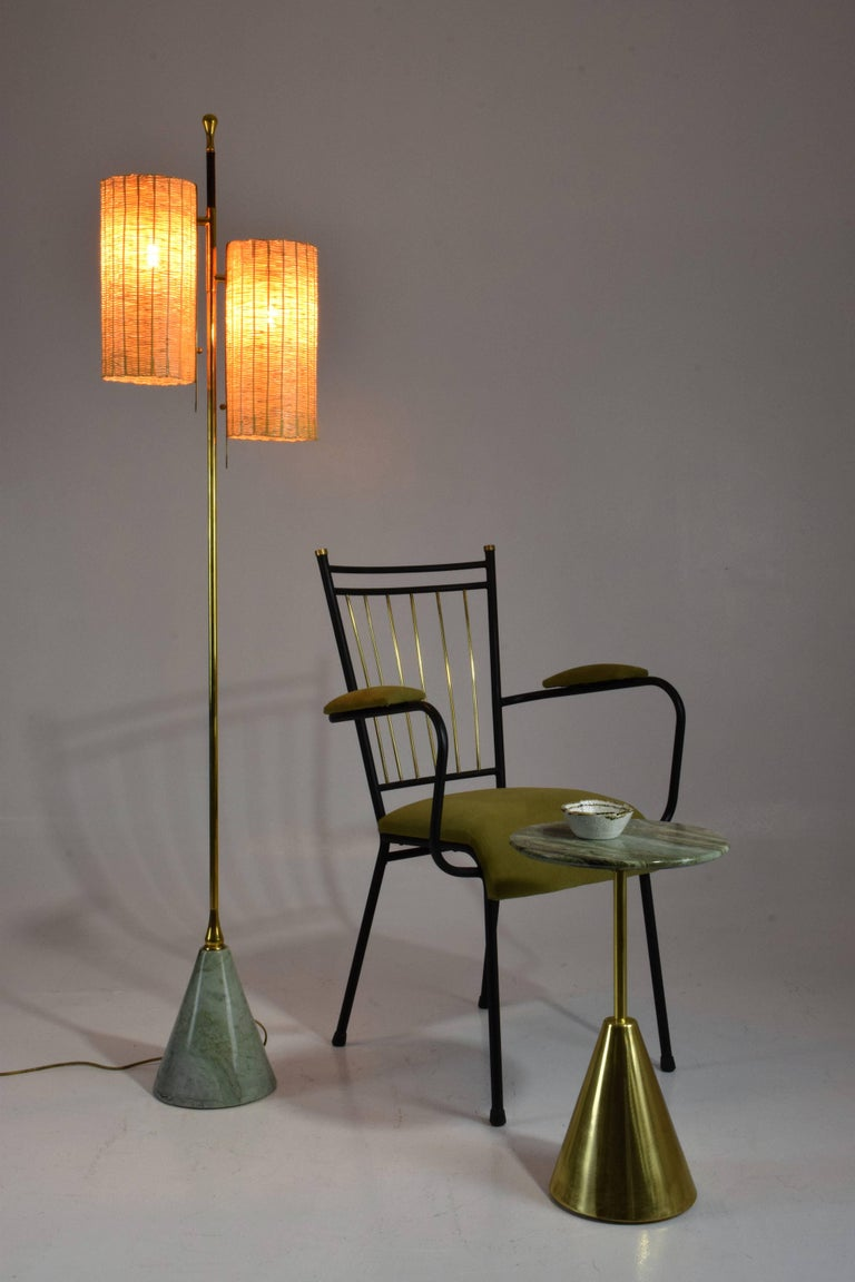 Contemporary handcrafted floor lamp composed of a solid brass structure adorned with a leather detail hand-pleated by artisan saddle makers, designed with two handwoven rattan cylinder lampshades and a green Moroccan Taznakht marble base.    Flow