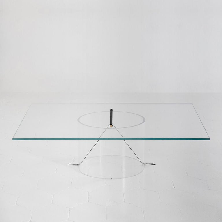 The core of the Equilibrium low table is represented by the transparency of its pure geometries, which allows for the central geometry of the connection to stand out, suspended in the middle. This configuration aims to make the structure disappear,