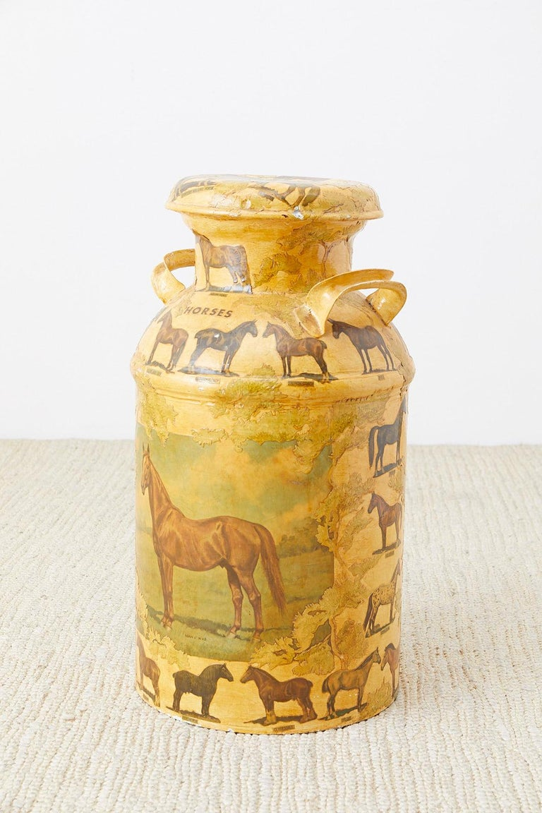 Whimsical decoupage decorated New England dairy farm lidded milk jug or bottle. Features an equine motif with images and labels of horses over a lacquered ground. Reminiscent of vintage Hermes scarf artwork in a folk art style. Heavy and solid metal