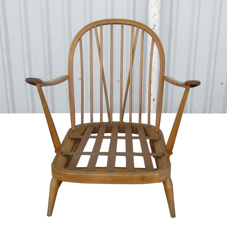 Vintage midcentury Ercol, British teak spindle settee. This stylish settee features patterned fabric, and spindle back support of teak material. A stylish and eye pleasing piece for any Retro furnished home.   This set includes the settee and