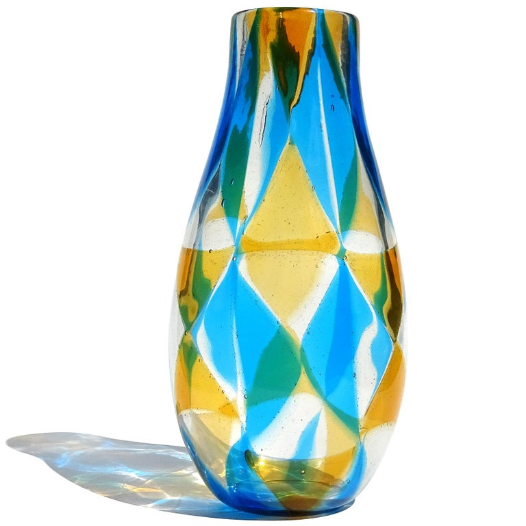 Rare Murano hand blown orange, blue and clear triangle Tessere mosaic Italian art glass flower vase. Documented to designer Ercole Barovier, for Barovier e Toso, circa 1961-1967 in the