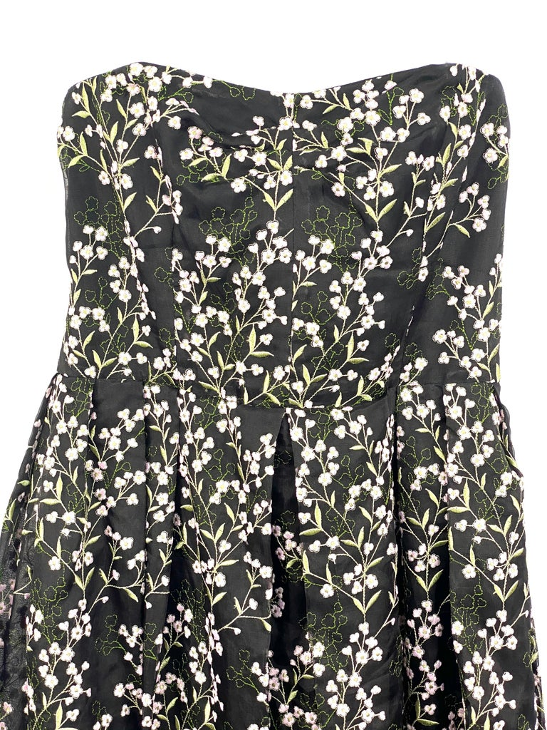 Edem Black Silk and Floral Pattern Evening Dress Size 8  Product details: Size US8, UK12 Strapless neck line cut  Midi length Pink and green flowers embroidery detail Size zipper and hook closure  Made in England